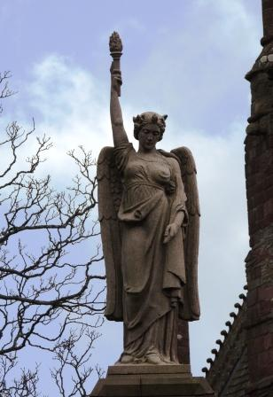Angel over gate to St Magnus Cathedral Graveyard Kirkwall